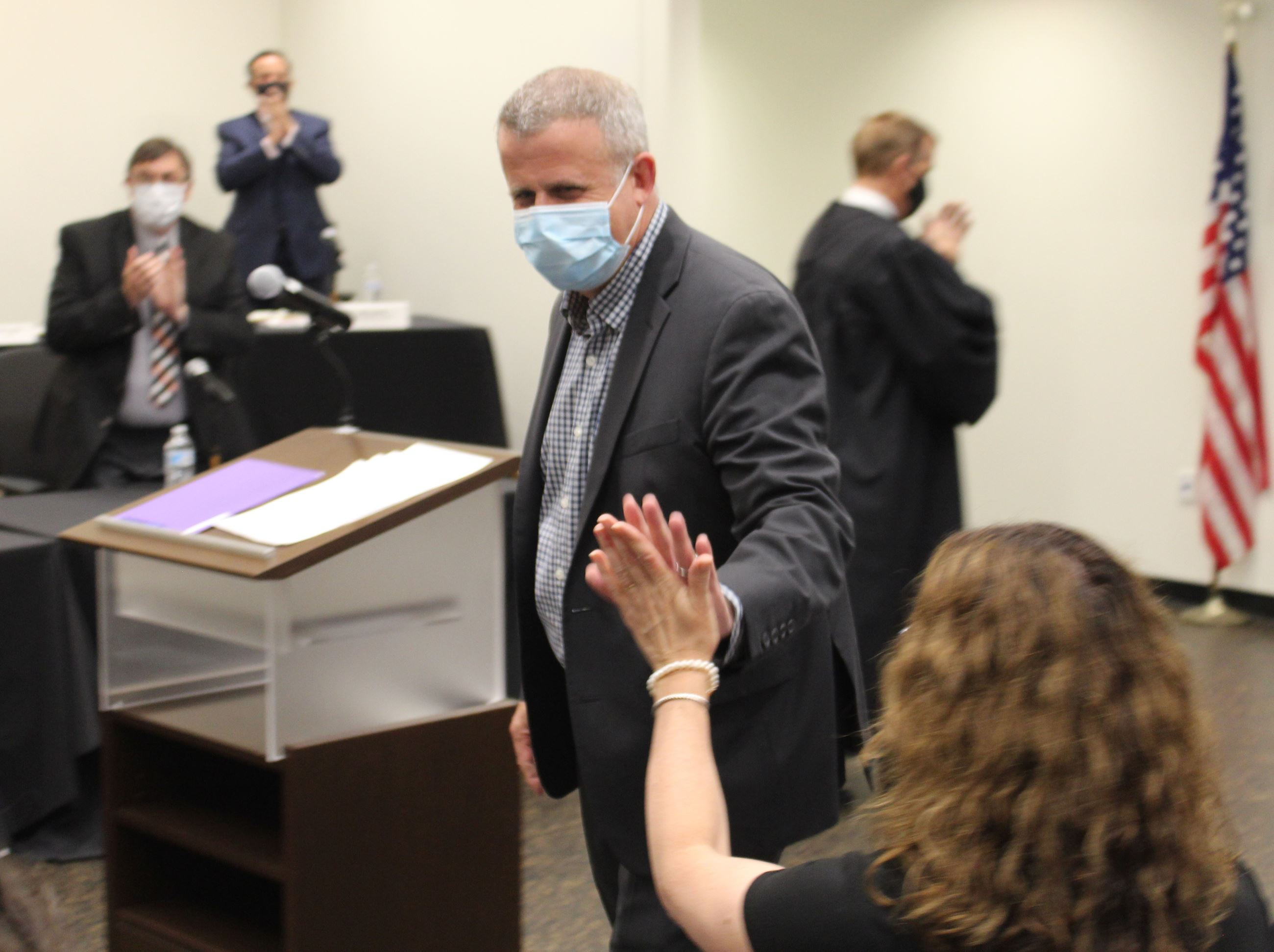 Mayor Cohen Barnes gives high fives to family members after taking the oath of office.